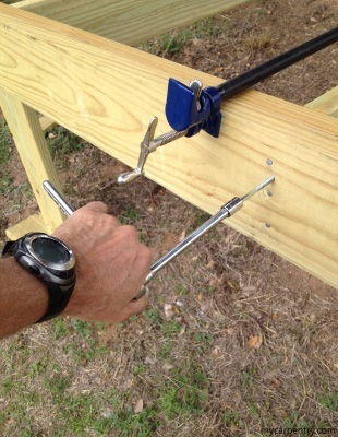 Fixing a bowed beam with a pipe clamp