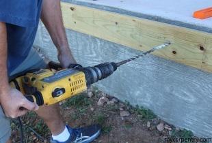 Attaching the Cedar Deck Leger to the concrete slab